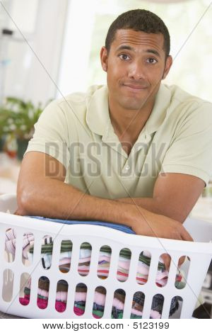 Man Leaning On Laundry