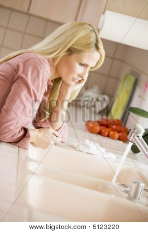 Woman At Kitchen Counter
