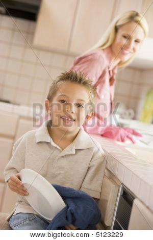Mother And Son Cleaning Dishes