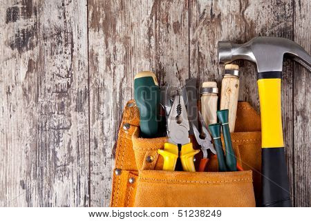 set of tools in tool box on a wooden background