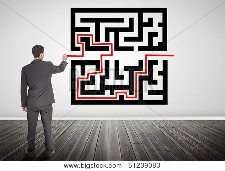 Businessman drawing a red line through qr code in empty room
