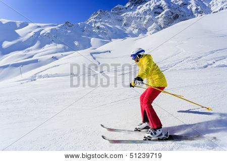 Ski, skier, winter sport - woman skiing downhill
