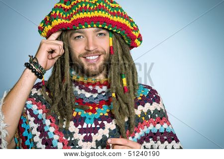 Portrait of a rastafarian young man.