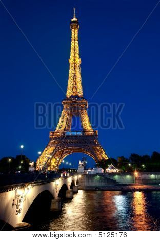 Illuminated Eiffel Tower At Dusk