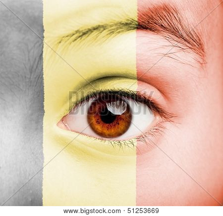 portrait of girl with flemish flag painted on her face