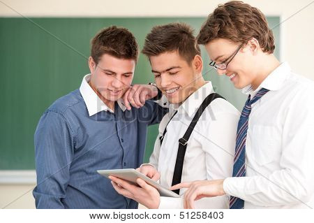 A group of handsome happy modern students
