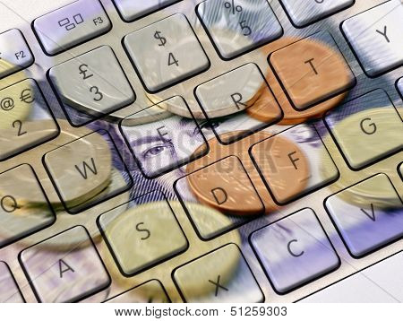 Closeup of computer keyboard overlaid with photo of UK money