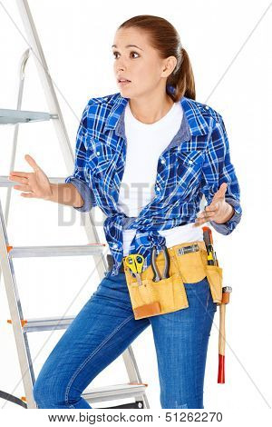DIY handy woman at her wits end raising her palms in the air to indicate that she does know the answer or have a solution to the problem