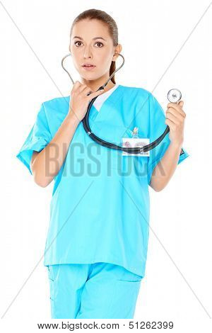 Friendly confident female doctor or nurse with a beautiful smile in green scrubs with a stethoscope isolated on white