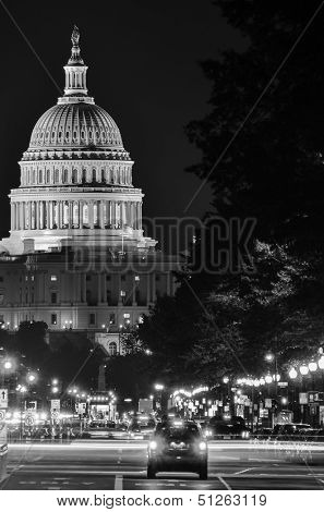Washington DC, United States Capitol building night view from from Pennsylvania Avenue with car lights trails - Black and white