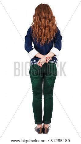 back view of standing young beautiful  redhead woman. girl  watching. Rear view people collection.  backside view of person.  Isolated over white background.  Girl in office attire stands back