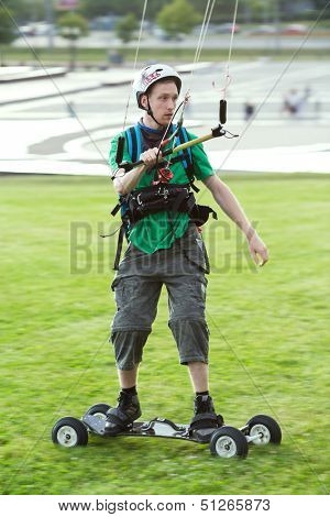MOSCOW - JUN 21: A sportsman in the helmet preparing for landkiting in park on Poklonnaya Gora on June 21, 2013 in Moscow, Russia.
