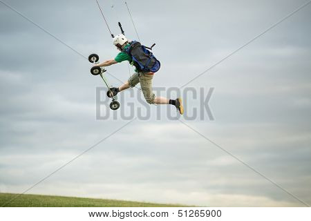 MOSCOW - JUN 21: A man in helmet flying during landkiting in park on Poklonnaya Gora on June 21, 2013 in Moscow, Russia.