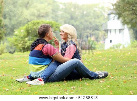 Young adn beautyful couple in the park