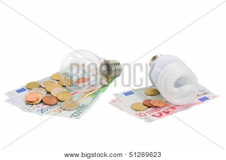 energy saving and normal   bulbs on euro money
