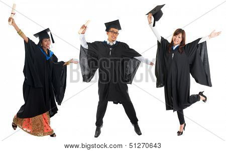 Full body group of multi races university student in graduation gown jumping isolated on white background