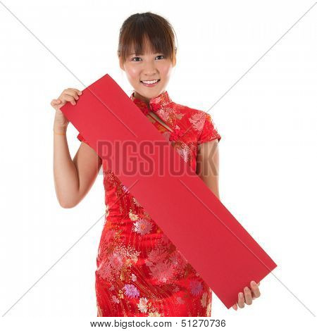 Asian woman with Chinese traditional dress cheongsam or qipao holding couplet, Isolated on white background.