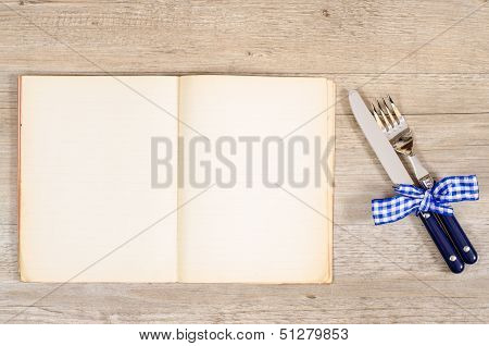 Blue Cutlery And Bow With Book And Text Space