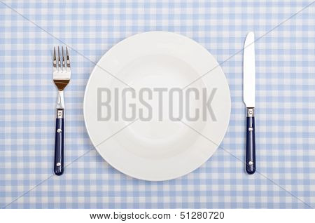 With Fork, Knife And Plate Covered Dinner Table
