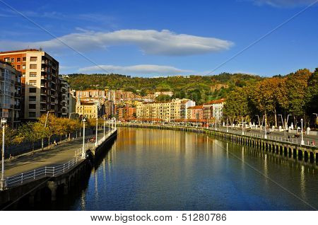 a view of the Estuary of Bilbao crossing the city, in Bilbao, Spain