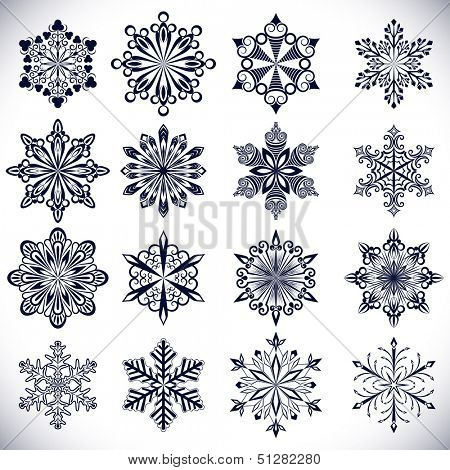 Ornate snowflake shapes isolated on white background.