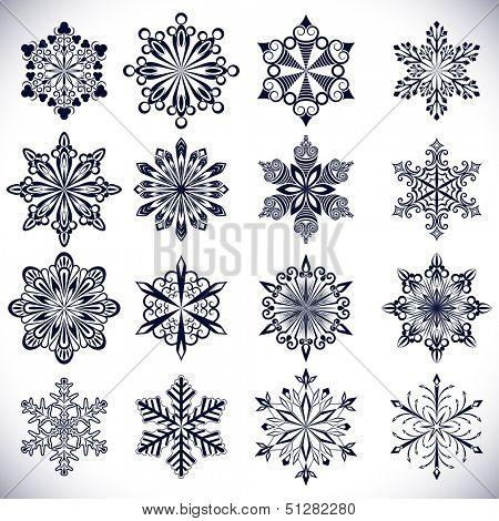Ornate snowflake shapes isolated on white background.