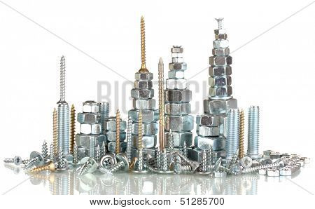 Many types of metal bolts, screws and nuts isolated on white