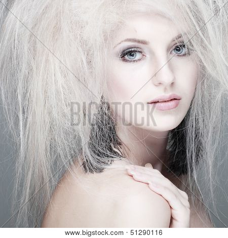 Closeup portrait of sexy whiteheaded young woman with beautiful blue eyes on grey background