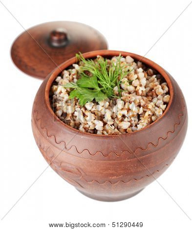 Buckwheat with verdure in pot isolated on white