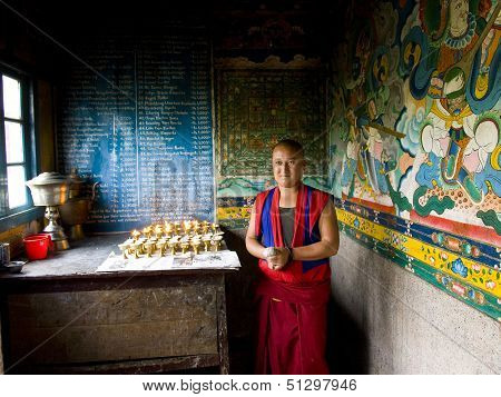 Sikkim - October 2010: A Buddhist Monk Lighting Candles In A Monastery