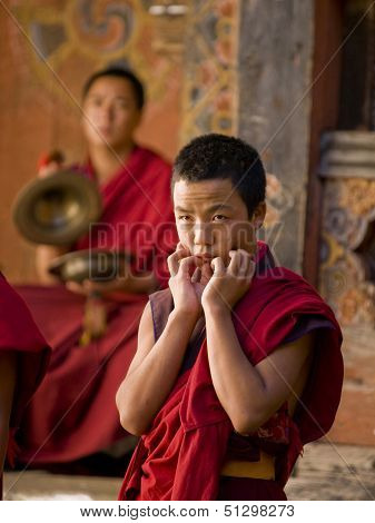 Trongsa, Bhutan - October 23, 2010: Anxious Looking Monk Waiting For His Rehearsal For The Trongsa T