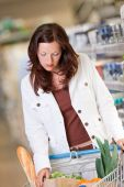 picture of grocery-shopping  - Young woman with cart shopping in a supermarket - JPG