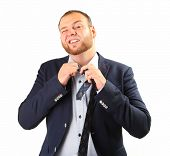 image of take off clothes  - tired businessman taking off necktie - JPG