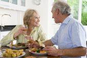 Elderly Couple Enjoying Meal, Mealtime Together poster
