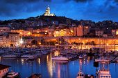 Marseille, France panorama at night. The famous european harbour view on the Notre Dame de la Garde