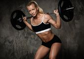 stock photo of muscle builder  - Beautiful muscular bodybuilder doing exercise with weights - JPG