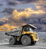 stock photo of iron ore  - Heavy mining truck driving through the iron ore opencast - JPG