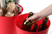 pic of segregation  - Putting glass bottle into recycling basket isolated - JPG