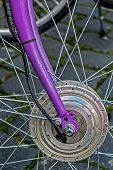 stock photo of dynamo  - Detail of the front wheels to the bike - JPG