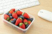 stock photo of lunch box  - Healthy lunch box in working desk - JPG