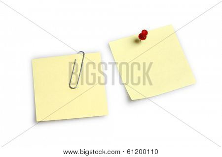 Two blank notes with pin and clip on white