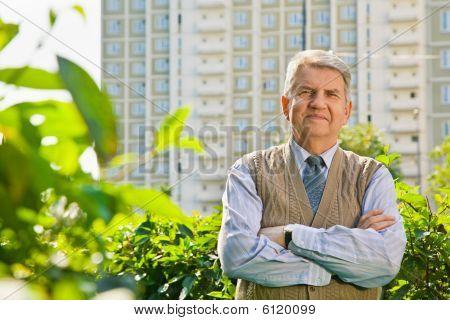 senior in park near building