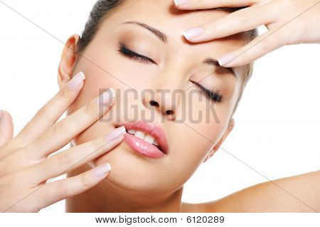 Asian Female  With  Beautiful Fingernails Near Her Face