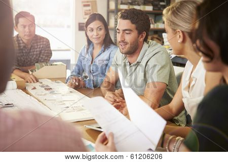 Six Architects Sitting Around Table Having Meeting