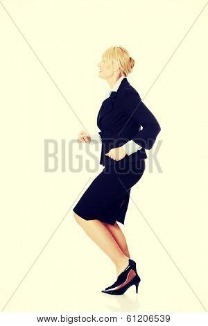 Middleaged businesswoman running