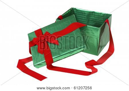 Green opened Christmas present box with red bow on white