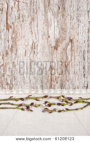 Easter Decoration With Catkins And Linen Fabric On Old Wood