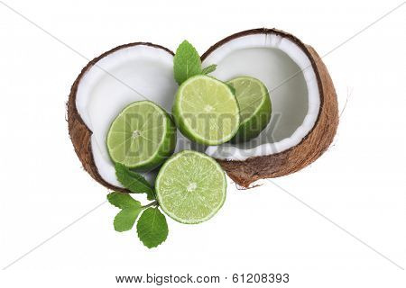 coconuts and lime with mint leaves on white background