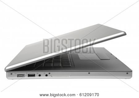 Silver laptop half closed on white background