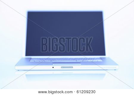 Silver laptop computer with bluish tone